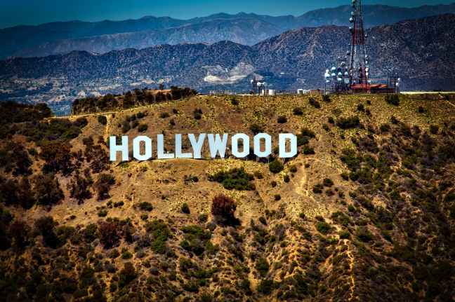 lighted hollywood signage during daytime